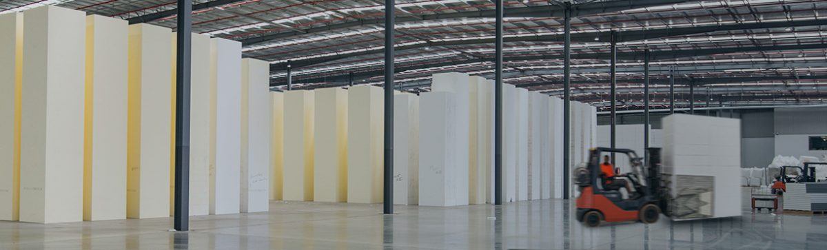 Large factory full of Geofoam blocks with operator moving product
